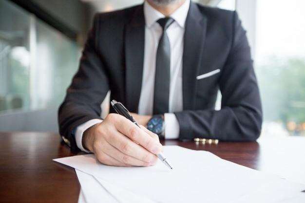 firma contrato - Contratos inteligentes: ¿son la ley del código? Aptus Legal